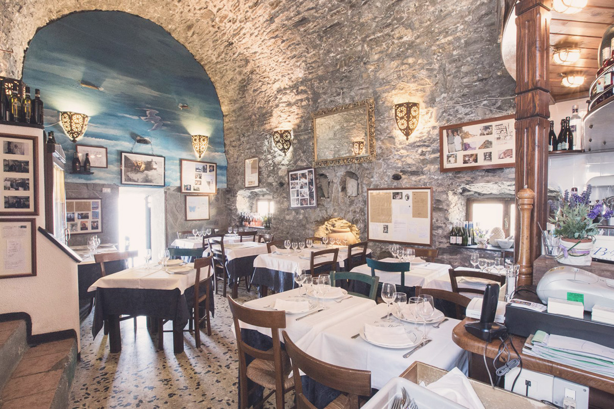 Restaurant on an ancient tower by the sea. Restaurants in